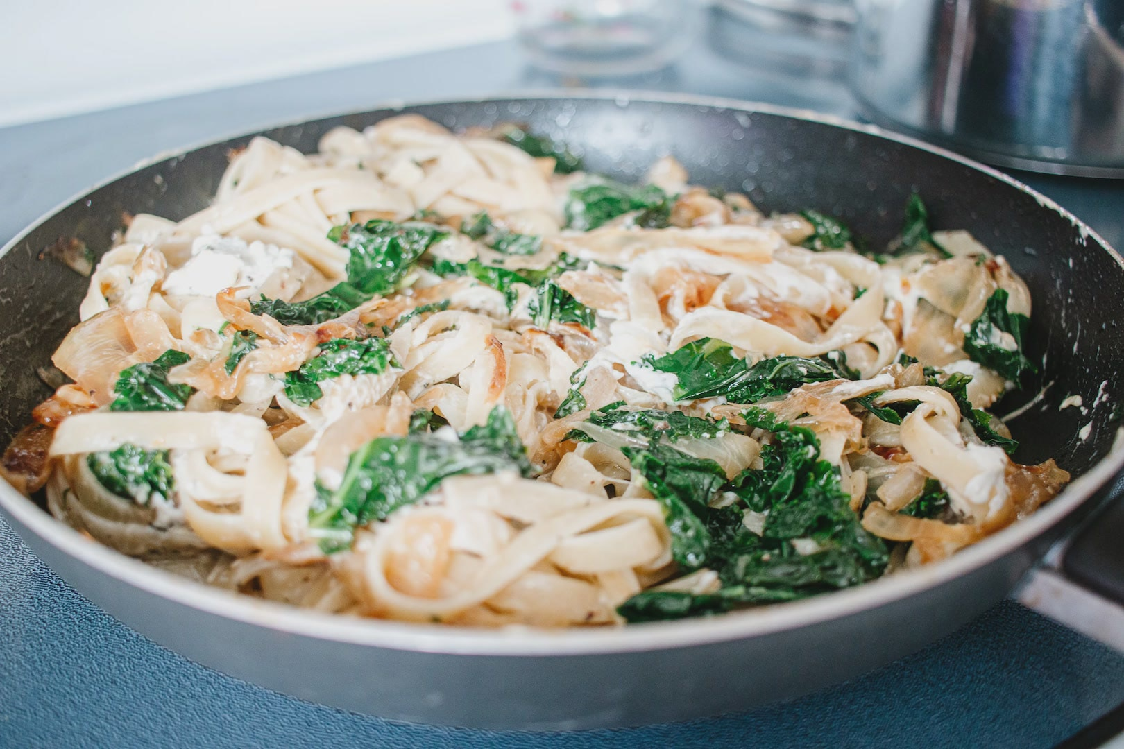 Fettuccine with Kale, Caramelized Onions and Goat Cheese